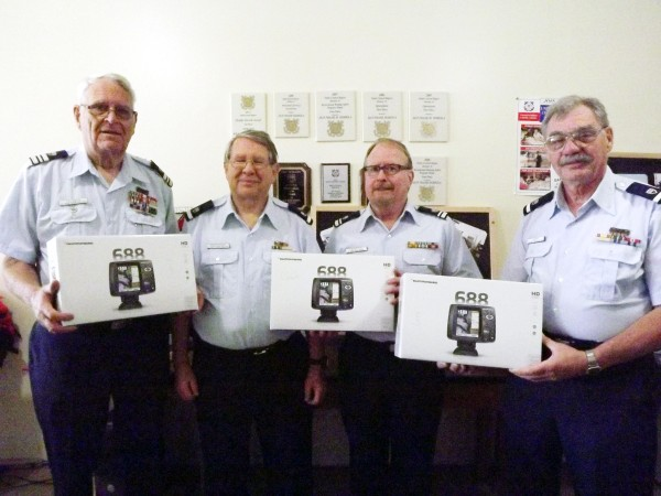 Pictured left to right: Charles Feldman, Flotilla Commander; Wayne Shoeppach, Larry Leighton; and Dennis Duford of the United States Coast Guard Auxiliary Flotilla 2603.