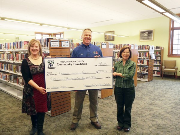 Pictured left to right are: Kathleen Lawrence, RCCF Trustee; Mike Burnside, RCCF Trustee; and Lisa Sutton, RADL Librarian.