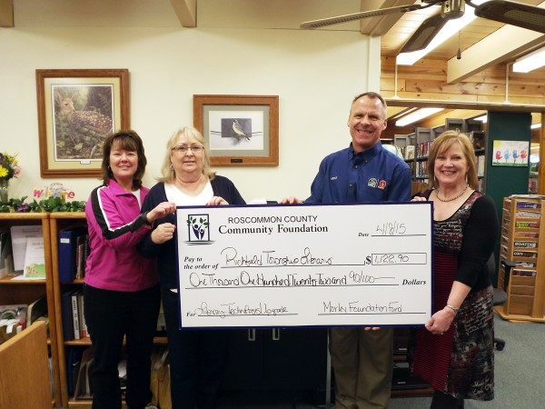 Pictured from left to right: Lynn Taylor, RTPL Director; Juli Dianics, RTPL Library Assistant; Mike Burnside, RCCF Trustee and Kathleen Lawrence, RCCF Trustee.