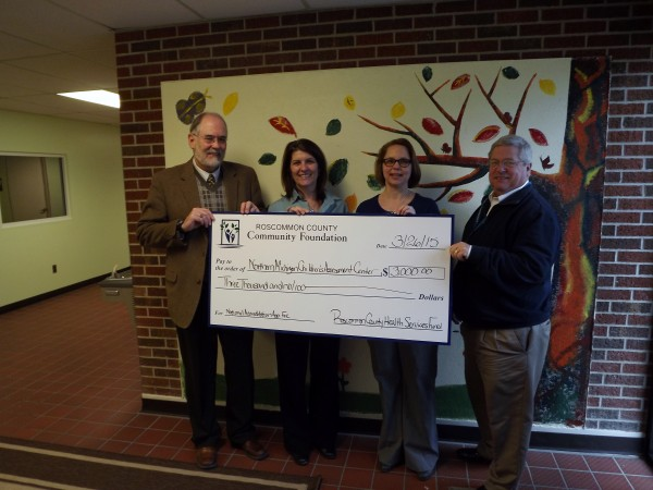 Pictured Left to Right: Darrell E. Milner, President of MidMichigan Community Health Services; Becky Yuncker, Executive Director of Northern Michigan Children's Assessment Center; Suzanne Luck, Executive Director of Roscommon County Community Foundation; and James Raschke, Executive Director of MidMichigan Community Health Services.