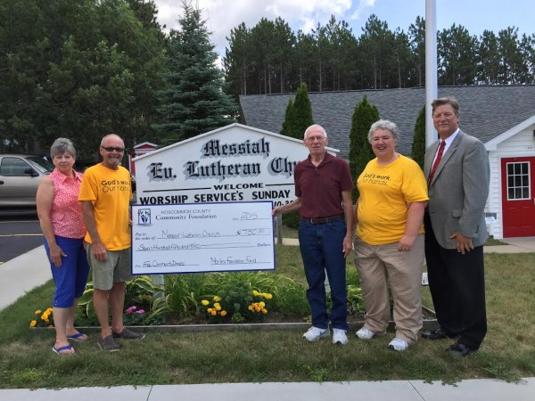 Pictured (left to right): Chris McManamon, Dinner Committee Cook; Mike McLosky, Dinner Committe Chairperson and Cook; Ed Pearen, Church Council President; Pastor Renee MacLeod; and Greg Rogers, RCCF Board Member