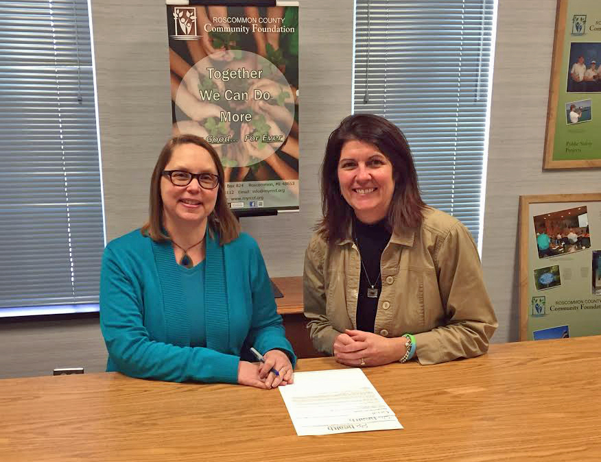 Becky & Suzanne signing agreement